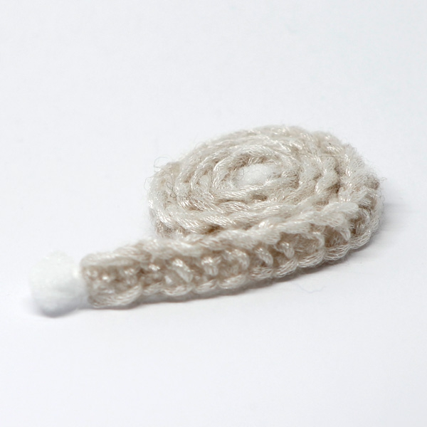 Handknitted pale Scarf with PomPoms